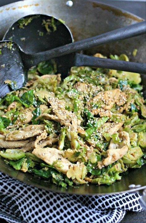 Chicken and Brussels Sprouts Stir Fry with Ginger and Sesame Seeds. A naturally gluten free and low carb stir-fry that is on the table in under 30 minutes!