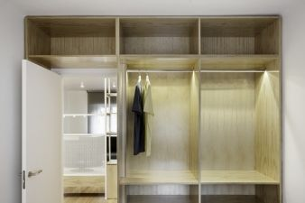 The closet envelops the door to the bedroom and includes lights