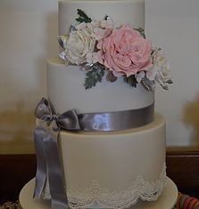 Silver and pink wedding cake with lace