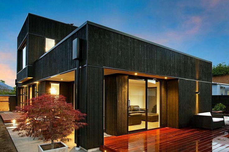 Dark horse House; night. Black cedar