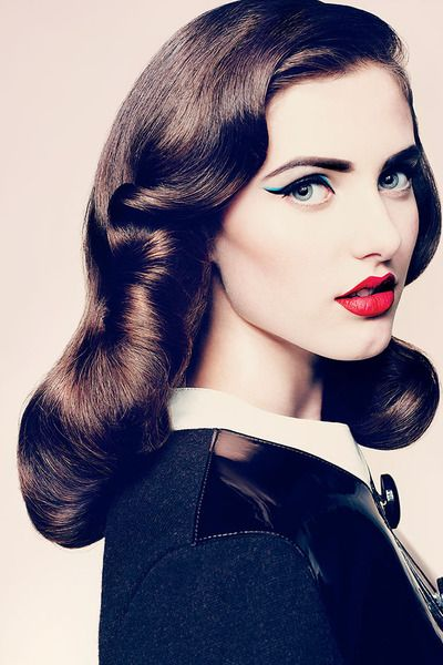 Retro hair and makeup from the 1940s. A signature look for vintage and modern pinup girls alike. We especially love the cat eye + cherry lip combo.