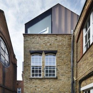 Zinc-clad roof extension to a private school in south London, which sets off against the building's existing brickwork