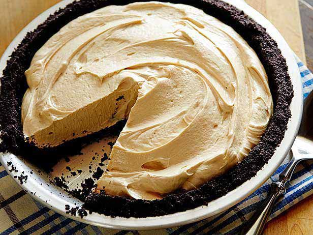 Chocolate Peanut Butter Pie from FoodNetwork.com Ingredients Crust: 25 whole chocolate sandwich cookies, such as Oreos 4 tablespoons butter, melted Filling: 1 cup creamy peanut butter One 8-ounce package cream cheese, softened 1 1/4 cups powdered sugar One 8-ounce package whipped topping, such as Cool Whip, thawed