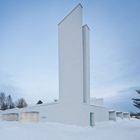 Whitewashed funeral chapel with a copper roof in Vantaa, Finland.