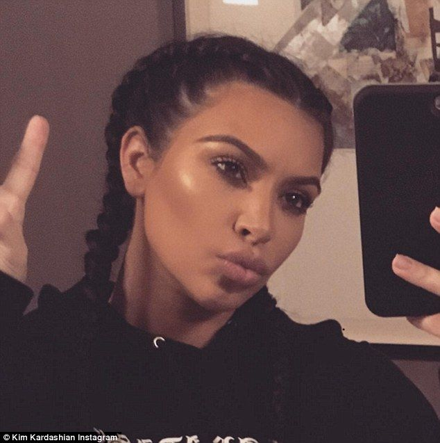 Kim Kardashian shows flowing locks and says shes back to reality