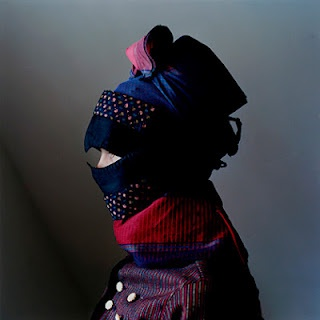 Denmark. The above picture is from Trine Søndergaard's photo series on strude, the complex scarves and hoods worn by 18th century women on the small Danish island of Fanø to protect their faces from the elements.""