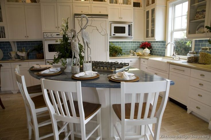 #Kitchen Idea of the Day: White Cottage Kitchen with blue countertops and blue subway tile backsplash.