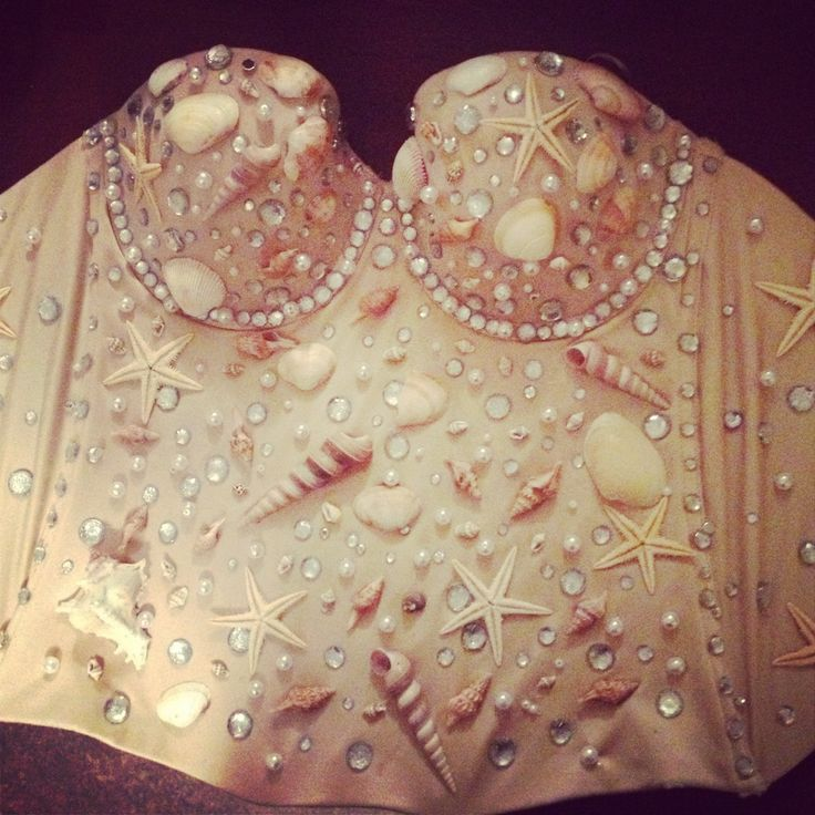 1. Buy a corset in a color of your choice and size (note: make sure that the material in the corset does not have much lace or rough material so that the objects will stay on better). 2. Buy materials you want to use on you corset. I went to hobby lobby and bought seashells, star fish, fake pearls, as well as rhinestones. You should be able to find these items at almost all craft stores.
