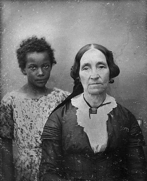 A New Orleans woman and the child she held in slavery, 1850 Hard to believe she would be so proud of having a slave that she had a photo with her. I'm hoping it was more like she was like a grandmother to the little girl. Sad.