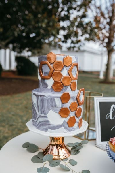 Modern wedding cake - geometric + marble wedding cake - two-tier wedding cake with gold hexagons  {Haniel Singh Photography}