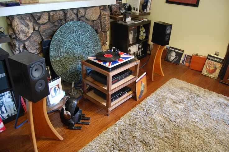 Rega based stereo system: RS1 speakers, Brio-R integrated amplifier, Apollo-R CD player/Transport, Rega DAC and RP6 turntable clad in Union Jack finish. This turntable comes with their TT PSU external power supply.  The speaker stands are by Quadraspire and the stereo stand is Trellis.