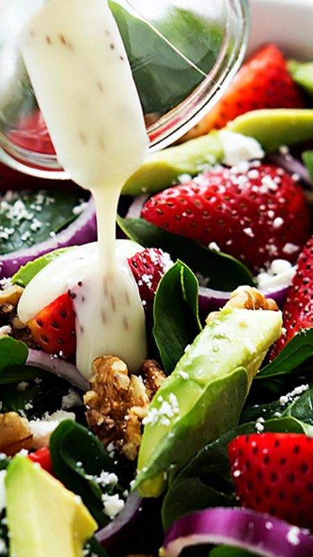 Healthy strawberry Avocado Spinach Salad ~ Strawberries, avocados, red onions, walnuts, and feta cheese all tossed with fresh baby spinach and creamy poppyseed dressing!