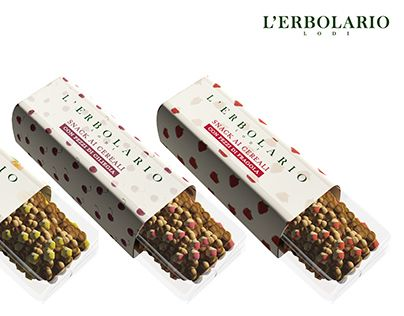 snack L'Erbolario • The project involves the designing of the pack of a cereal bar for the italian brand L'Erbolario. The snack is decorated with pieces of fruit. The variants of taste imagined are apricot, cherry, strawberry, apple, pear and plum. The bar is standard: 100gr for a total size of 9,5x1,5x3cm. • http://on.be.net/1Irq3WG