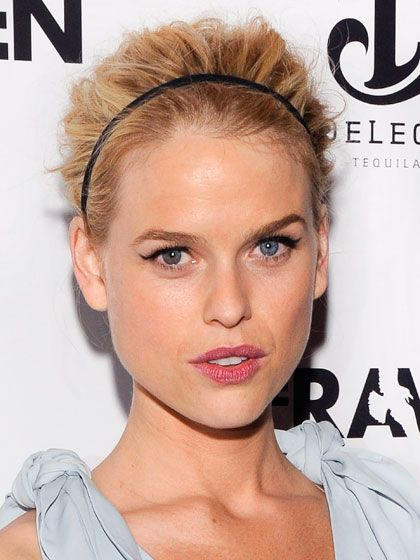 UP  Roughed-Up Do    Close to the head in front of a headband and volume behind it give Alice Eve an edgier take on a classic style. Cranford suggests that a French twist in the back would be a perfect complement. To keep the volume on top from looking stiff, place a few hairpins in the teased back section. It creates an airy, raked-with-your-fingers look.