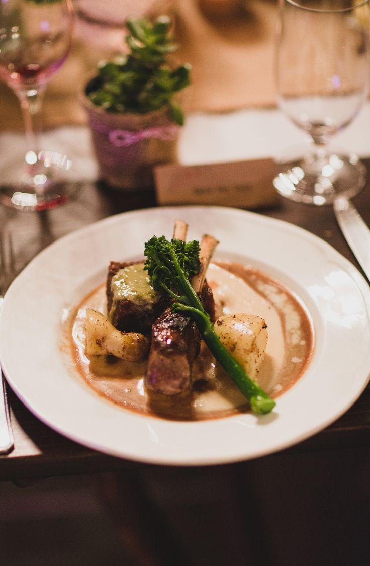 Lamb rack with confit shoulder, potato and white bean puree and green olive vinaigrette. Photo Credit: Jason vandermeer