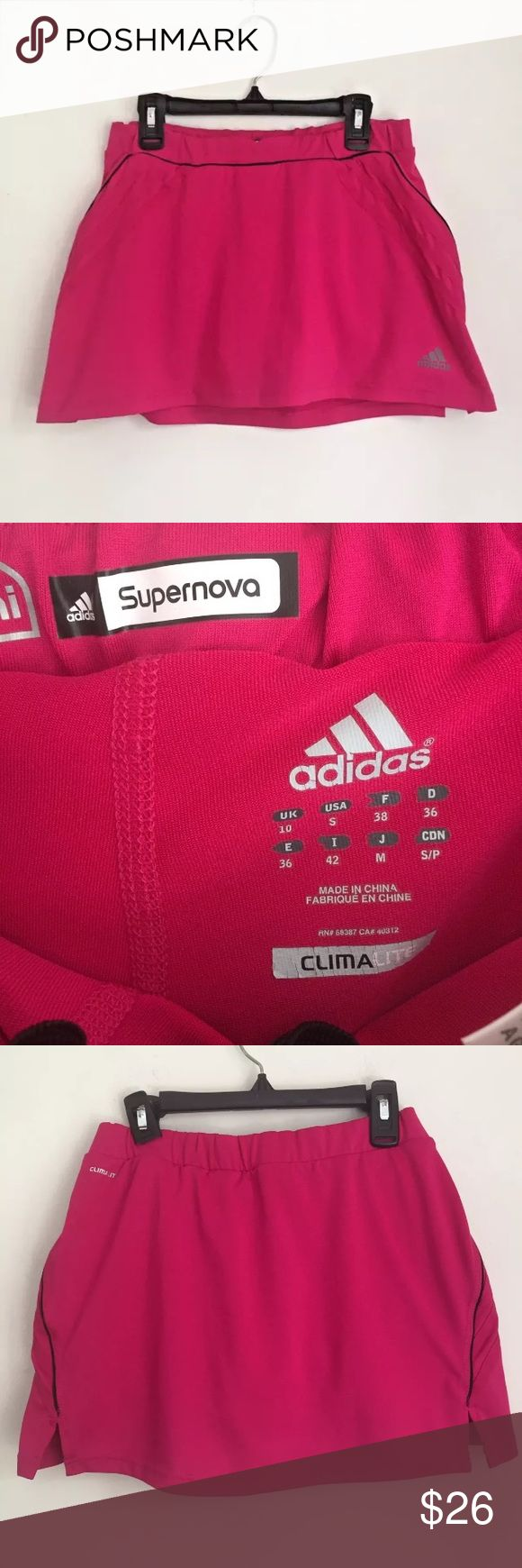 "Adidas Super Nova Pink Tennis Skirt Adidas Supernova ClimaLite Pink Golf Tennis Skirt Skort   Shorts Underneath  Pre-owned in great condition with no flaws  Women's Size S  Measures 14"" across waist laying flat. Length is 12"" adidas Shorts Skorts"