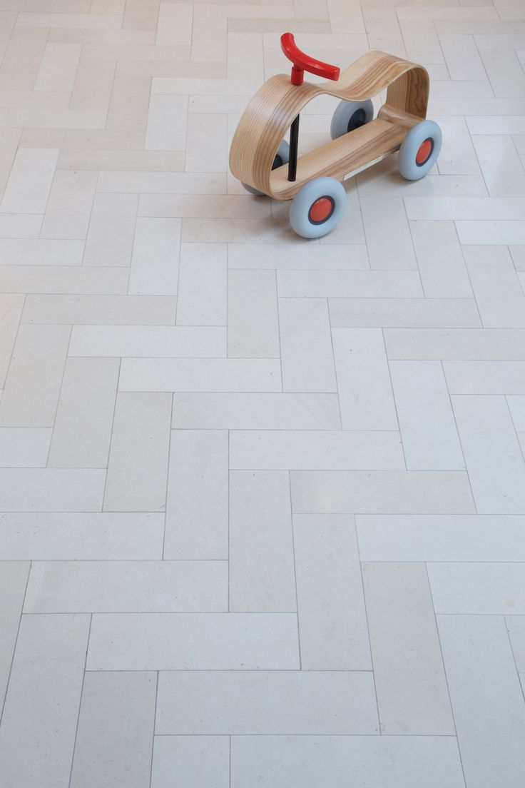 Parquet limestone tiles perfect for a Shaker style kitchen. Tiles from Artisans of Devizes. www.artisansofdevizes.com