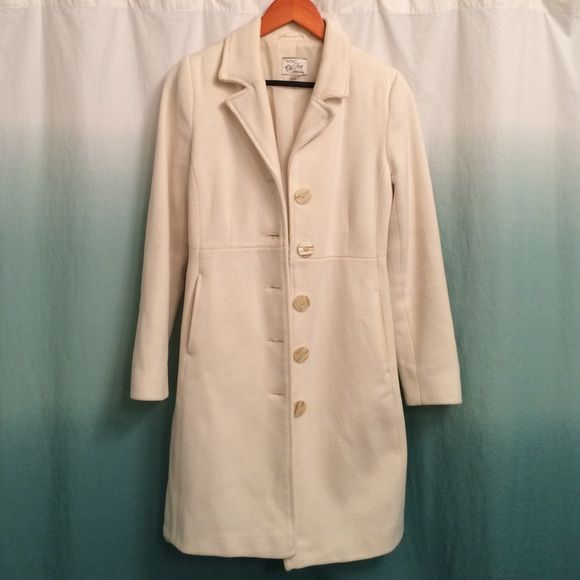 Old Nav, size S, ivory button down coat Old Nav, size S, ivory button down coat. Button detail on sleeves. Two front pockets. Very small snag on bottom left front of jacket (see last picture). Old Navy Jackets & Coats Pea Coats