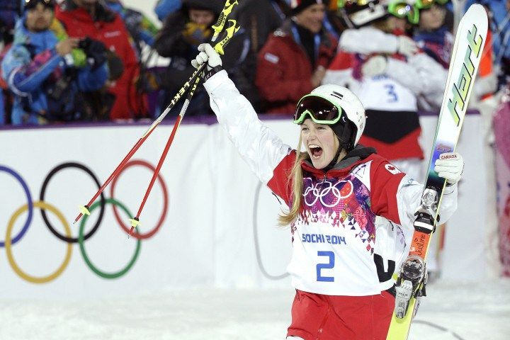 Canada's Justine Dufour-Lapointe celebrates after winning the gold medal in the women's moguls at the 2014 Winter Olympics, Saturday, Feb. 8...