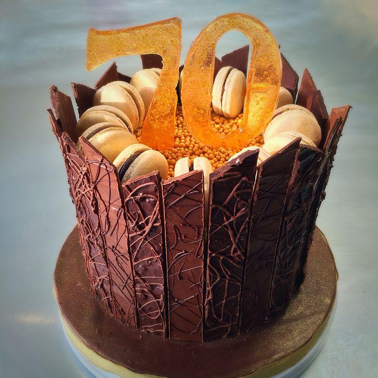Chocolate cake with ginger buttercream, milk and dark chocolate shards with crystallised ginger. Ginger Macaron decoration. Handmade Sugar 70