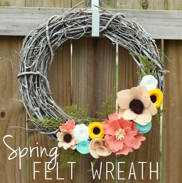 Awesome spring felt wreath by her party pants.com.  This painted stick wreath with made by hand felt flowers with bright colors can take you from spring right into summer!  I love it!  www.herpartypants.com