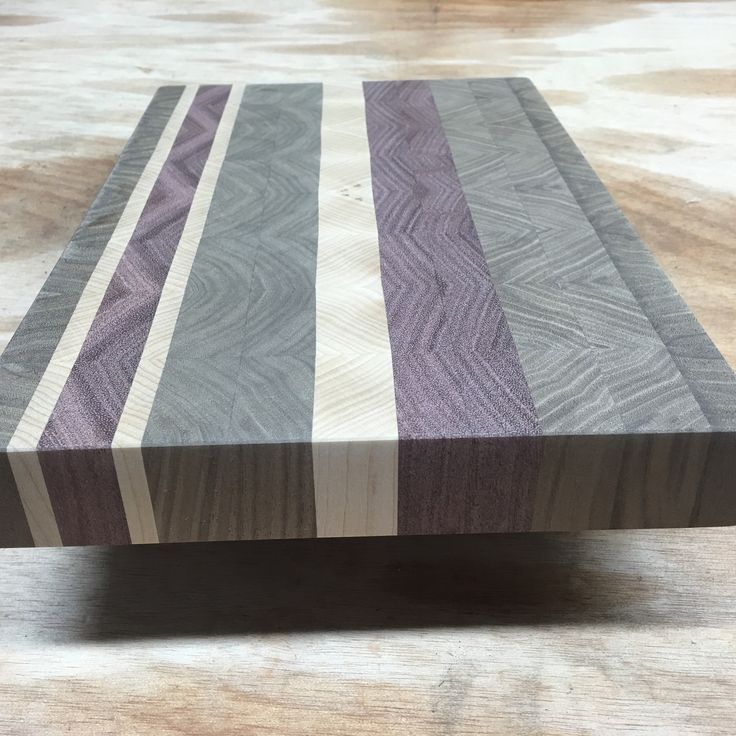Fantastic end grain cutting board made with hard maple, walnut and purple heart wood..