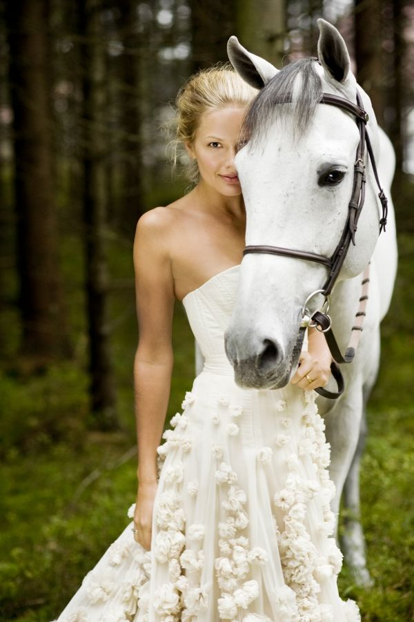 wedding dress and grey horse