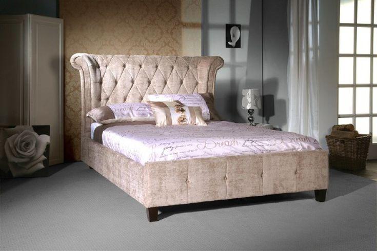 The Epsilon upholstered velvet bed frame has a striking mink finish.