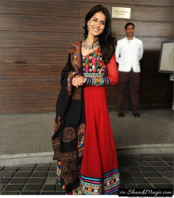 Genelia Wears Kutch Style Embroidery Anarkali Suit.  Another Kutch embroidery Anarkali suit worn by Genelia D'Souza Deshmukh is an interesting piece of cloth that we loved it so far. All my eyes divert to her black dupatta which is perfect pair up with the red that has got so much of heavy embroidery design.
