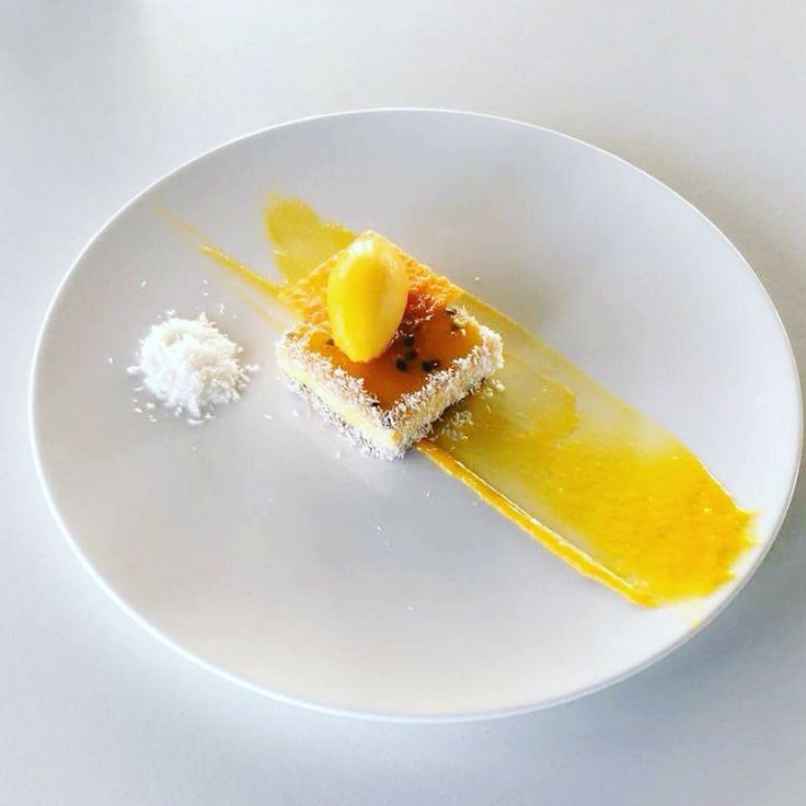Tonight dessert of the day at apocalypsis exotic fruit cheescake! Mango cheescake,sauce mango,passion fruit nappage,sorbet mango,coconut,tuile mango