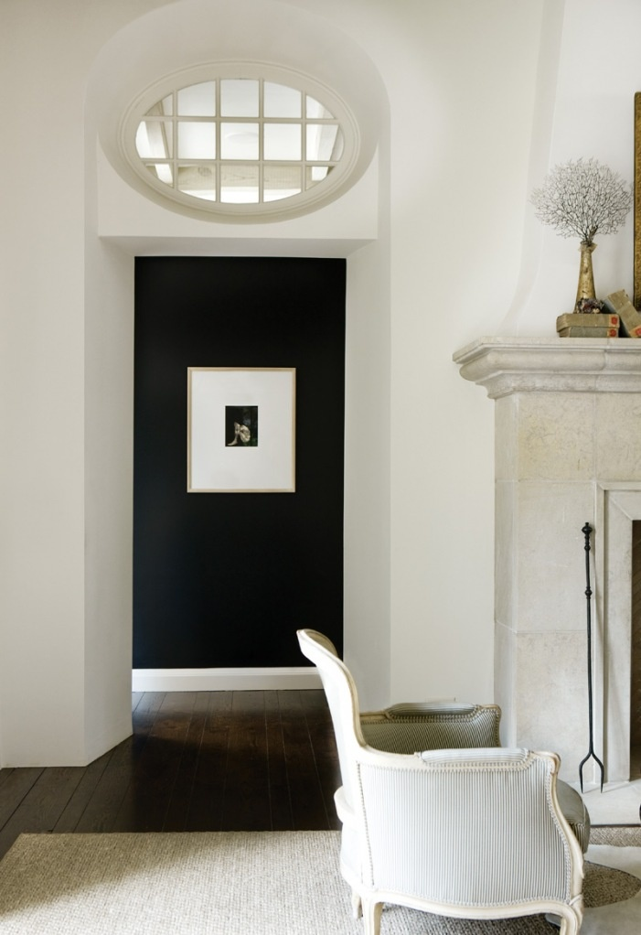 Love the dark wall color contrasted against the other white walls.