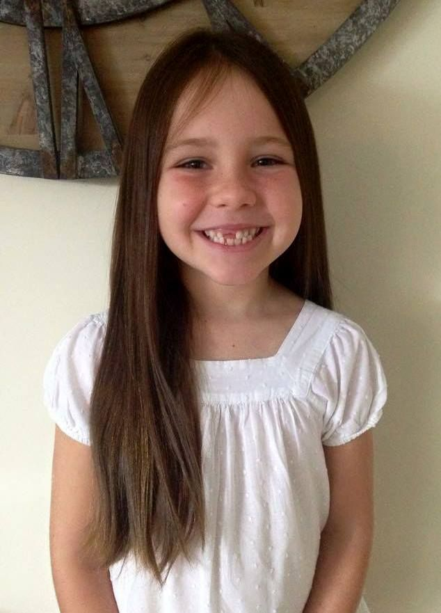 "Meet gorgeous 6 year old Taylah. After hearing about cancer on the radio, she decided to cut at least 8 inches off her long hair ""to give it to children whose hair falls out so they can feel beautiful and special."""