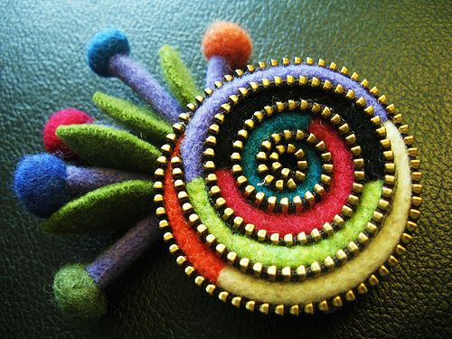 zip-felt jewelry. Look here http://pinterest.com/pin/32228953554857027/  to see technic, how to. Good luck!