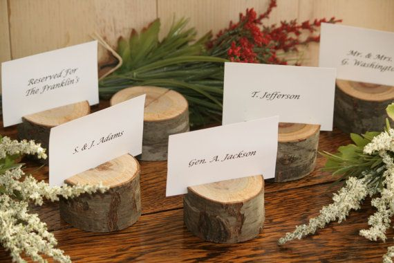 Rustic place card holders range in the size of approximately 1 and 3/4 inches to 2.5 inches in diameter and are approximately 1.5 inches tall.
