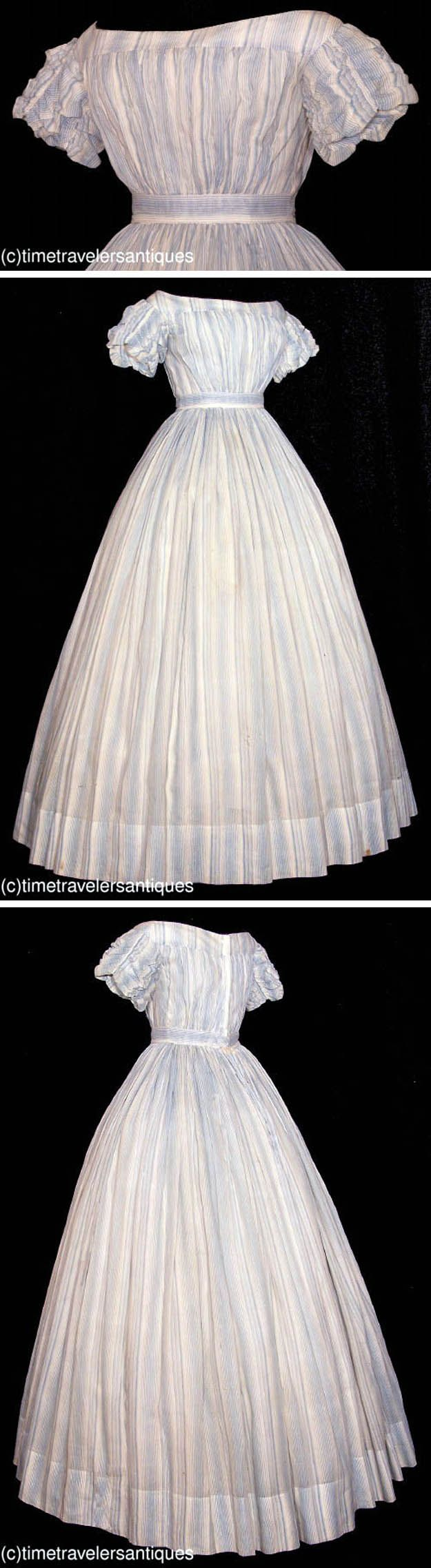 Civil War: Summer dress ca. 1860s. One piece; powder blue striped muslin with pleated bodice & ruched sleeves. Piped at the neckline, armscyes, and waistband. Blind back hook & eye closure. Bodice lined in muslin. Unlined skirt is finely cartridge-pleated, with single slit pocket and deep faced hem. Time Travelers Antiques via Extant Gowns
