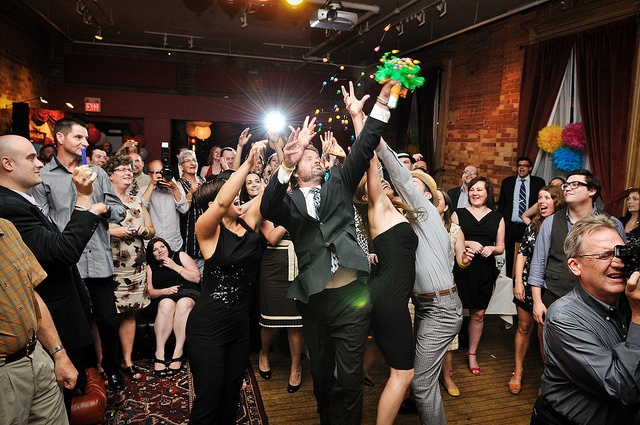 """Jessica and Peter's spectacular carnival-themed wedding at The Gladstone Hotel, with a """"Lucky Bouquet"""": gumballs and lottery tickets!"""
