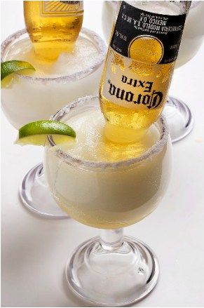 If you want to try something unique and amazingly delicious, try a Mexican Bulldog Margarita. This lime margarita in a large glass with a Corona stuck…