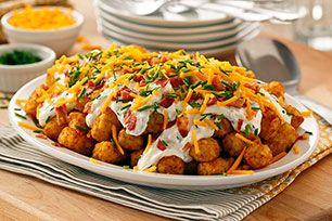 Nachos at breakfast time? Yes, when they're made with ORE-IDA TATER TOTS! Top your Totchos with bacon, sausage and eggs for a guaranteed good morning.