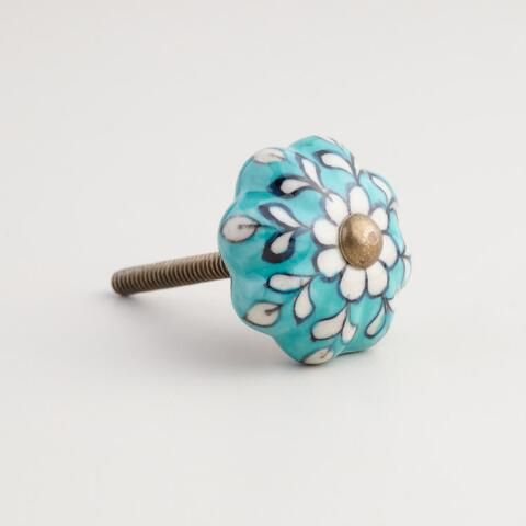 Our ceramic knobs from India are hand painted with a floral design that adds well-traveled style to your nightstand or dresser drawers.