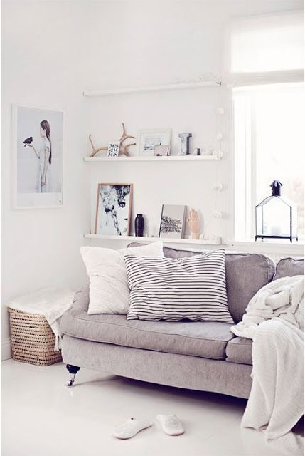 light gray velvet English roll arm sofa + huge black and white stripe pillow. perfect.