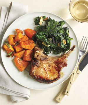 Roasted Pork Chops and Butternut Squash With Kale | Get the recipe: http://www.realsimple.com/food-recipes/browse-all-recipes/roasted-pork-chops-and-butternut-squash-with-kale-00000000049713/
