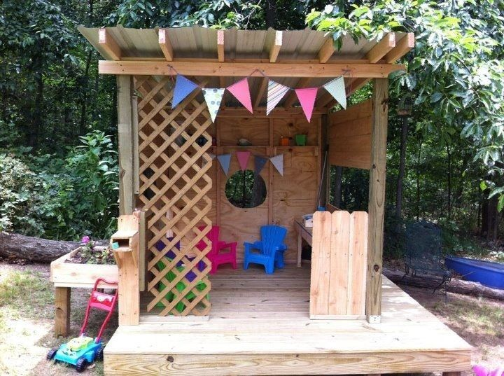 Playhouse with mailbox, personal garden, sitting area, chalkboard, mud kitchen, walk around porch and private parking space - so fun! #toddlerplayhouse