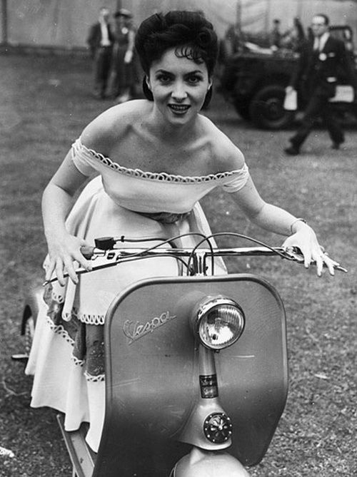 Gina Lollobrigida on a Vespa, 1950s. How about an unusual bridal entry?