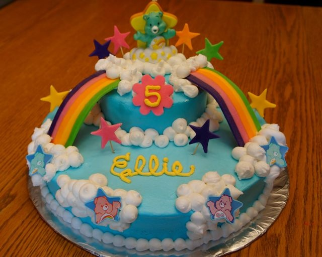 Care Bears cake - Super easy and the little girls just squealed with delight when she saw it... SUCCESS!  Rainbow and stars made out of fondant, the rest is buttercream.  Care Bear topper is a candle & Care Bear stars are cupcake rings.