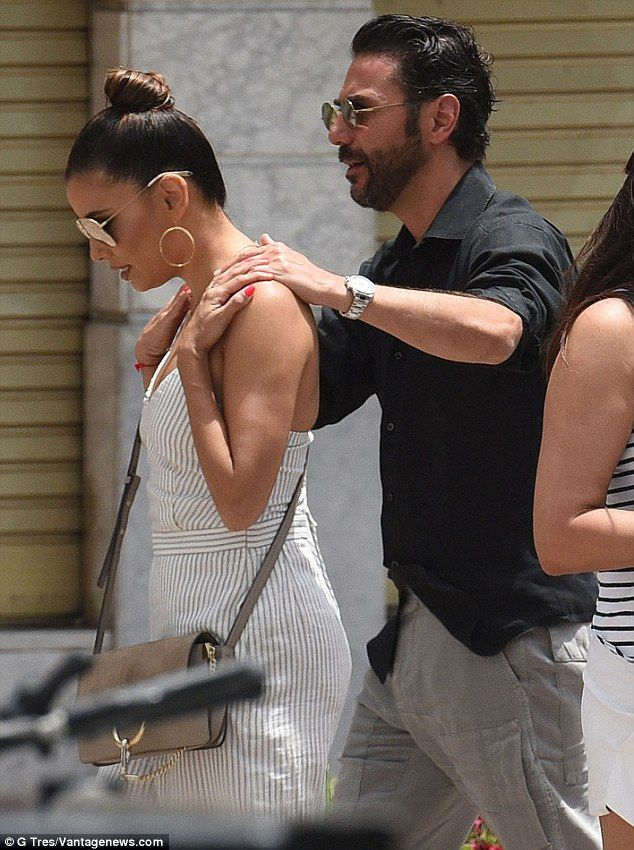 Shoulder rub: Pepe rubbed his wife's shoulders as they walked around...
