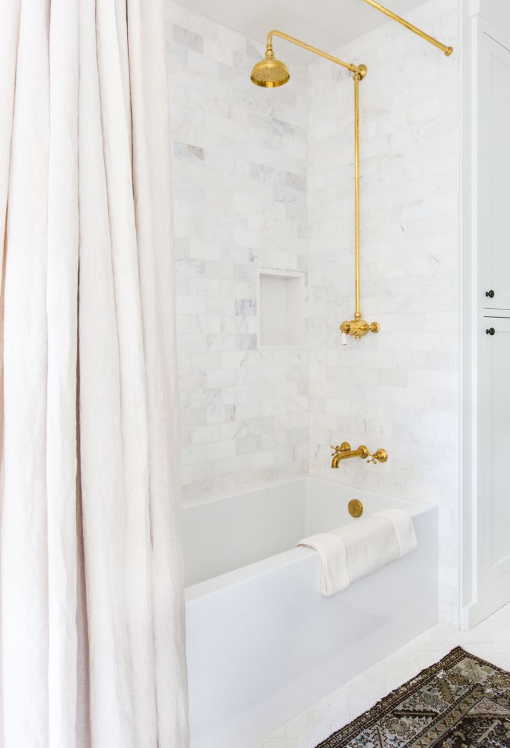 Shower drain furthermore stone look wall tile additionally modern - Love The Shower Curtain Brass Fixtures And Tile