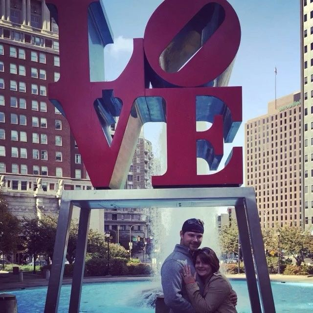 When Natalie booked a trip to Philadelphia as a birthday present for James she didn't know he had a surprise for her. James took Natalie to the JFK Plaza and in front of the LOVE Sign he proposed! #Congratulations to @squeee5477 and @saharacon87 we are so happy to have been a part of this special moment! #ThankYou! #EngagementRing #EngagementStory #DesignYourMoments.