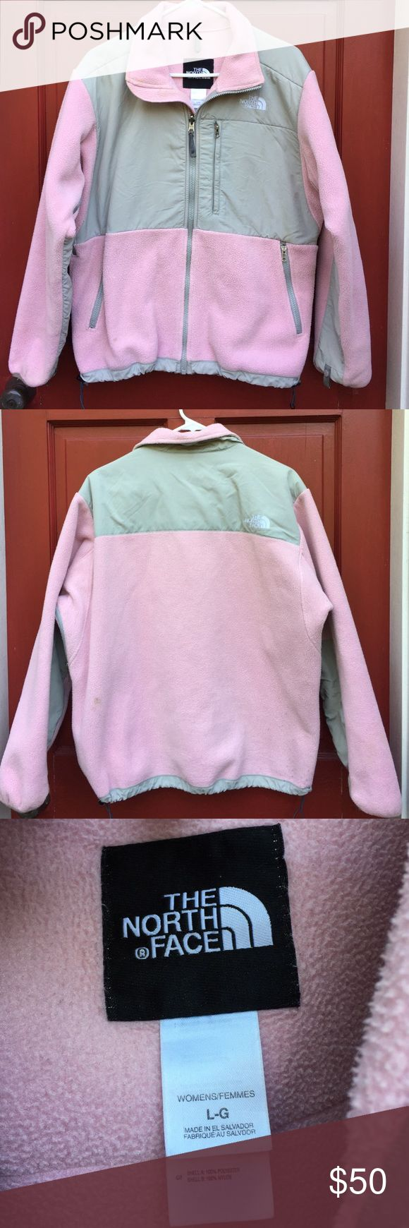 North Face women's pink fleece jacket size L North Face women's fleece pink zip up jacket size L. Used, in good condition. There is a stain on the front left, bottom of the jacket. North Face Jackets & Coats