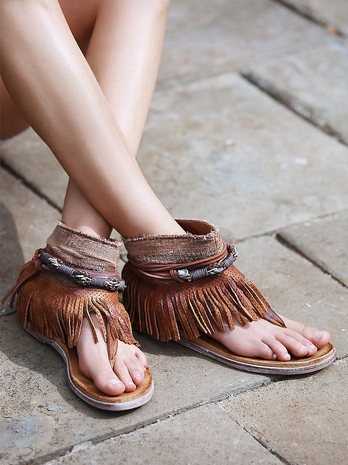 Wonder Land Fringe Sandal | Leather thong sandals with an embellished ankle shaft, featuring a perforated leather fringe and braided and cord wraps. A pull-on style.   *By Free People   *Modern and sartorial styles, artisan crafted from fine leathers and premium materials, FP Collection shoes are coveted for their signature cutting-edge aesthetic.