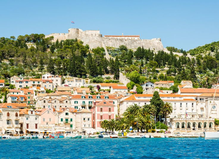 Hvar Hvar, Croatia tree sky water outdoor Town geographical feature Boat vacation human settlement cityscape Sea palace Coast bay Village Resort surrounded